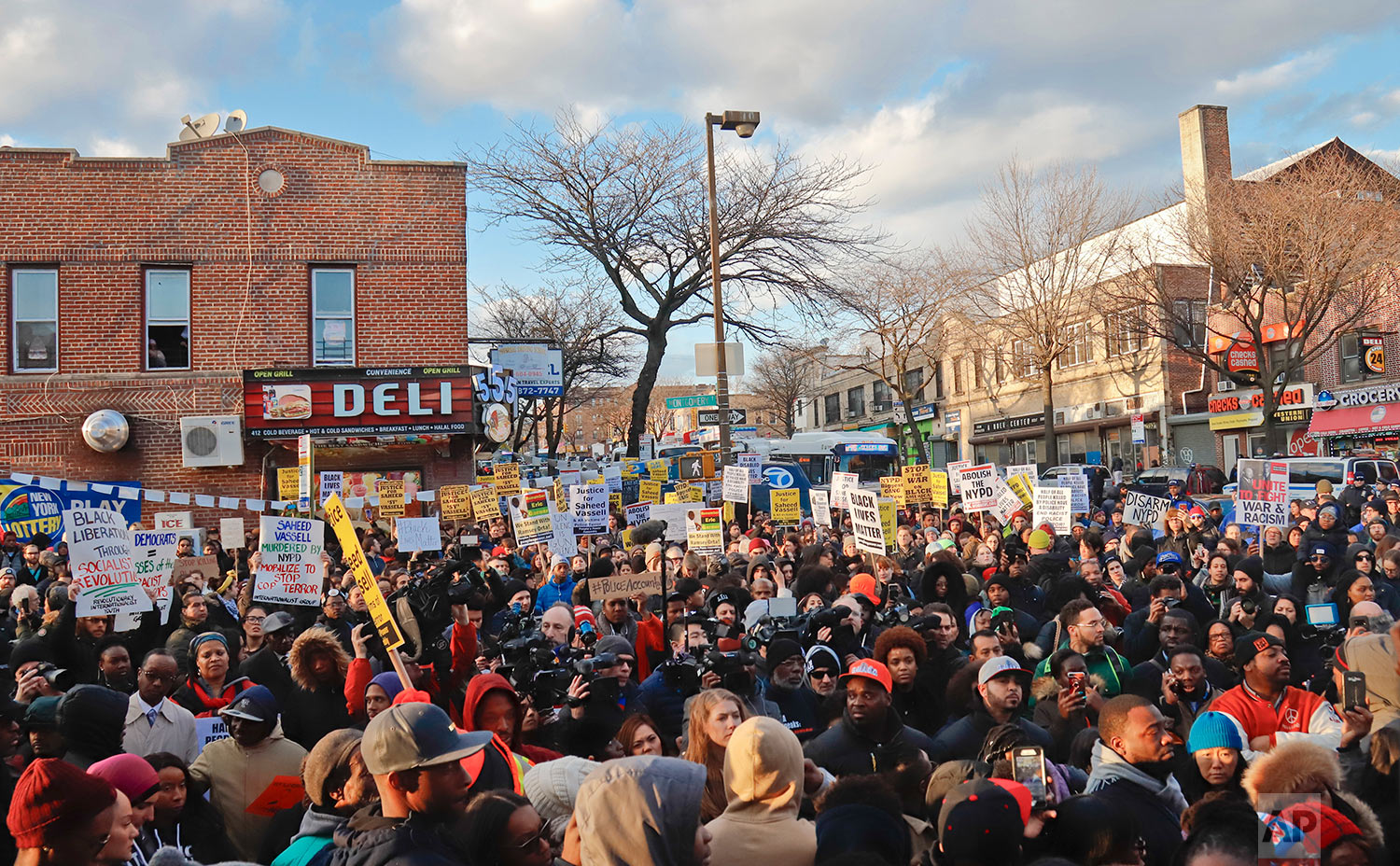Hundreds rally for a march to the 71st Precinct on Empire Boulevard, Thursday, April 5, 2018, in the Crown Heights neighborhood of Brooklyn, in New York, to protest the fatal police shooting of Saheed Vassell, a 34-year-old welder and father of a teenage son who was fatally shot by New York Police Department officers a day earlier. (AP Photo/Bebeto Matthews)