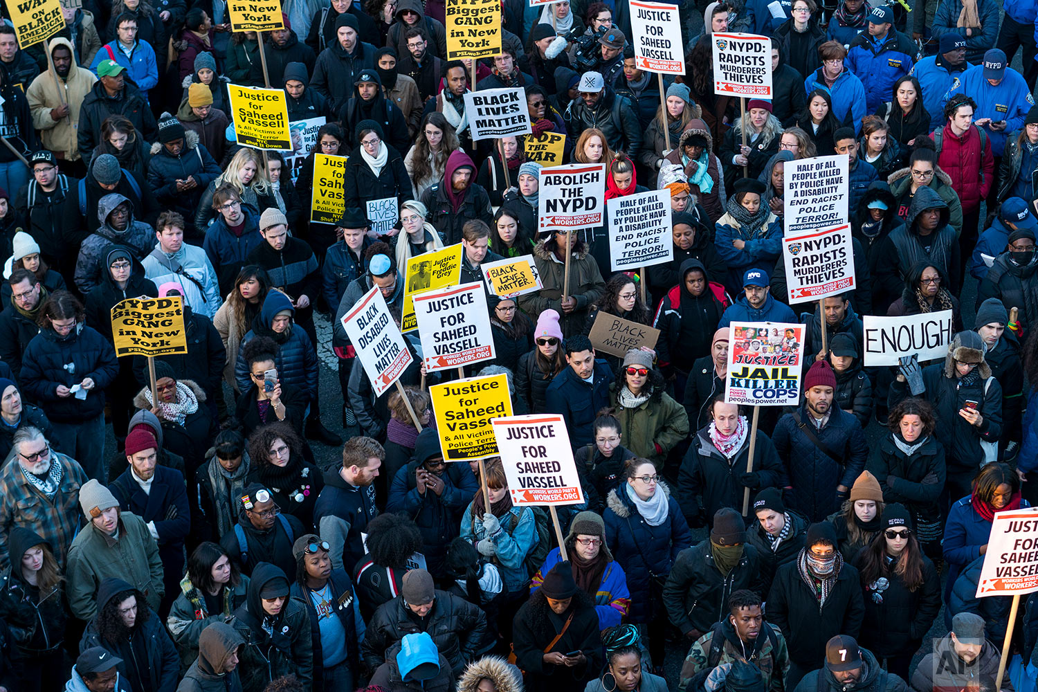 Hundreds rally for a march to the 71st Precinct on Empire Boulevard to protest Wednesday's fatal police shooting of Saheed Vassell, a 34-year-old father of a teenage son, Thursday, April 5, 2018, in the Brooklyn borough of New York. (AP Photo/Craig Ruttle)