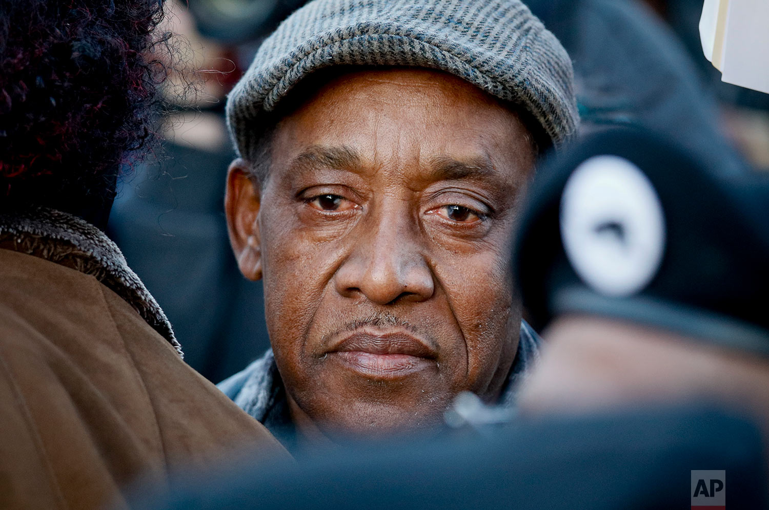 Eric Vassell listens during a rally, Thursday, April 5, 2018, in the Crown Heights neighborhood of Brooklyn, in New York, for his son Saheed Vassell, a 34-year-old welder and father of a teenage son who was fatally shot by New York Police Department officers a day earlier. (AP Photo/Bebeto Matthews)
