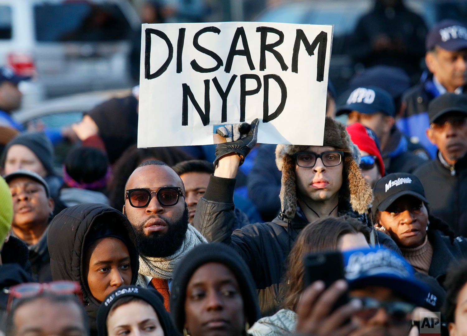 Hundreds rally for a march to the 71st Precinct on Empire Boulevard to protest Wednesday's fatal police shooting of Saheed Vassell, a 34-year-old father of a teenage son, Thursday, April 5, 2018, in the Crown Heights section of Brooklyn borough in New York. (AP Photo/Bebeto Matthews)