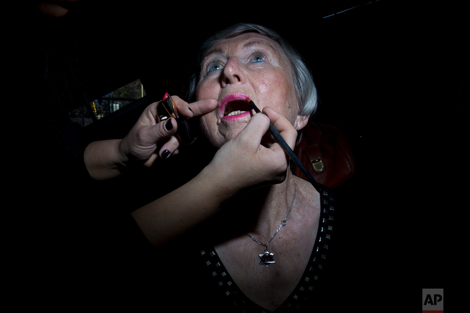 Holocaust survivor Hannah Beker, 79, gets her makeup ready during a Beauty Heroines event in Ramat Gan, Israel, Monday, April 9, 2018.  (AP Photo/Oded Balilty)