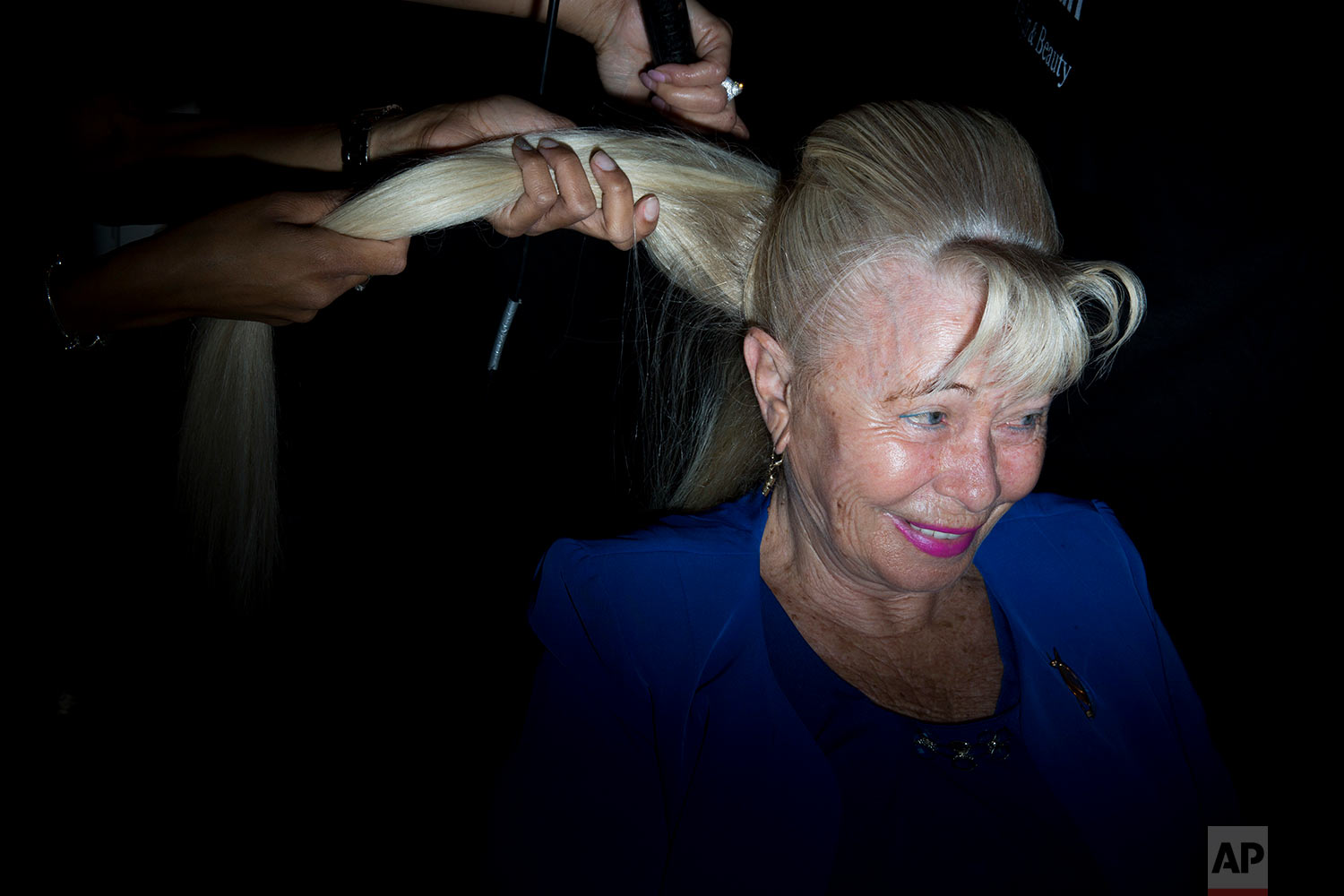 Holocaust survivor Dvorah Weinstein, 80, gets her hair done during a Beauty Heroines event in Ramat Gan, Israel, Monday, April 9, 2018. (AP Photo/Oded Balilty)