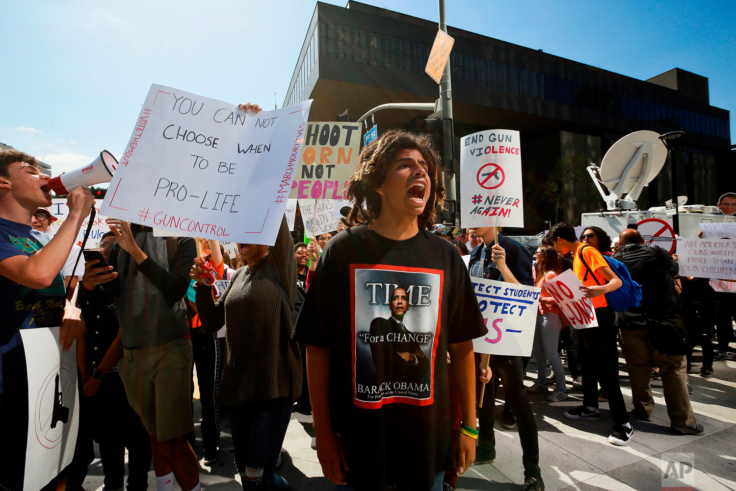 High school student Sebastian Chavez, center, joins hundred of students walking out of school to rally against against gun violence, Friday, April 20, 2018, in downtown Los Angeles Friday, April 20, 2018. Protests were held across the country Friday, on the 19th anniversary of the Columbine High School shooting. (AP Photo/Damian Dovarganes)