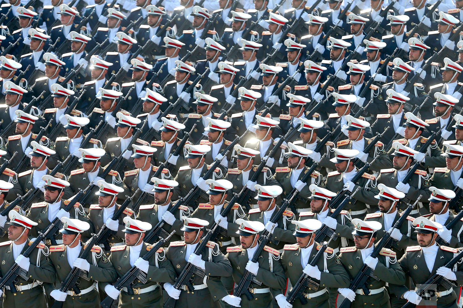 Troops march in a parade marking National Army Day in front of the mausoleum of the late revolutionary founder Ayatollah Khomeini, outside Tehran, Iran, Wednesday, April 18, 2018. (AP Photo/Ebrahim Noroozi)