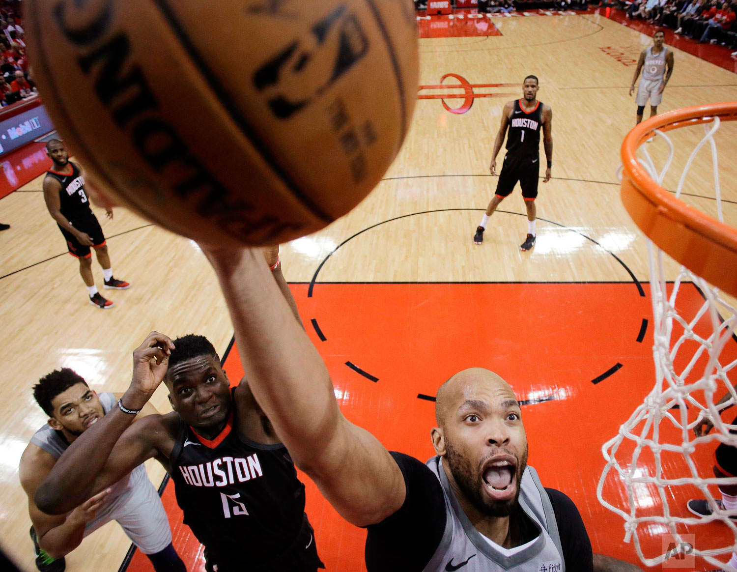 Minnesota Timberwolves forward Taj Gibson, right, shoots as Houston Rockets center Clint Capela (15) defends during the second half in Game 2 of a first-round NBA basketball playoff series, Wednesday, April 18, 2018, in Houston. (AP Photo/Eric Christian Smith)
