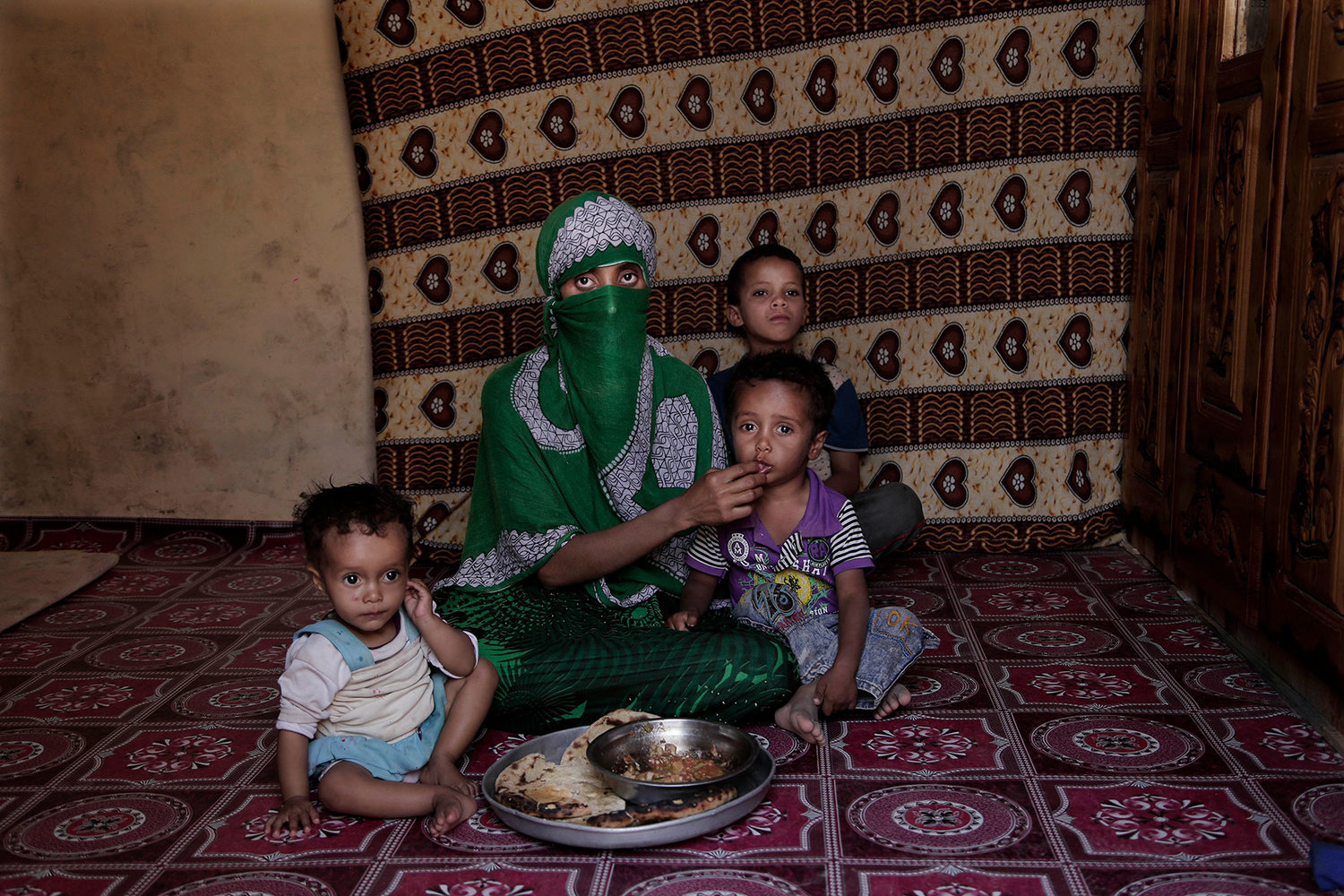 Sherine is shown with her children, Al-Mallah, Yemen. (AP Photo/Nariman El-Mofty)
