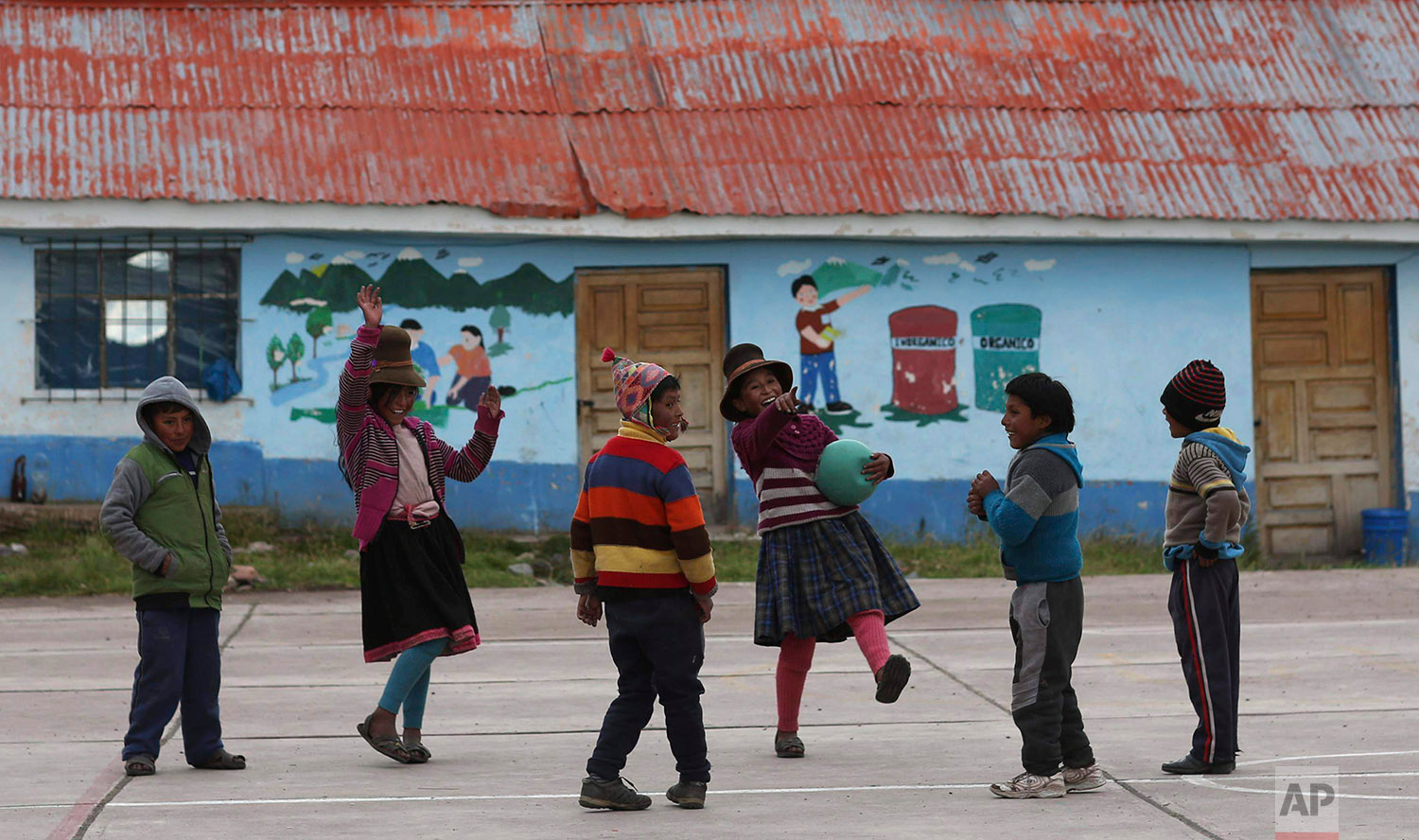 In this April 4, 2018 photo, children play in their schoolyard in Pitumarca, Peru.(AP Photo/Martin Mejia)