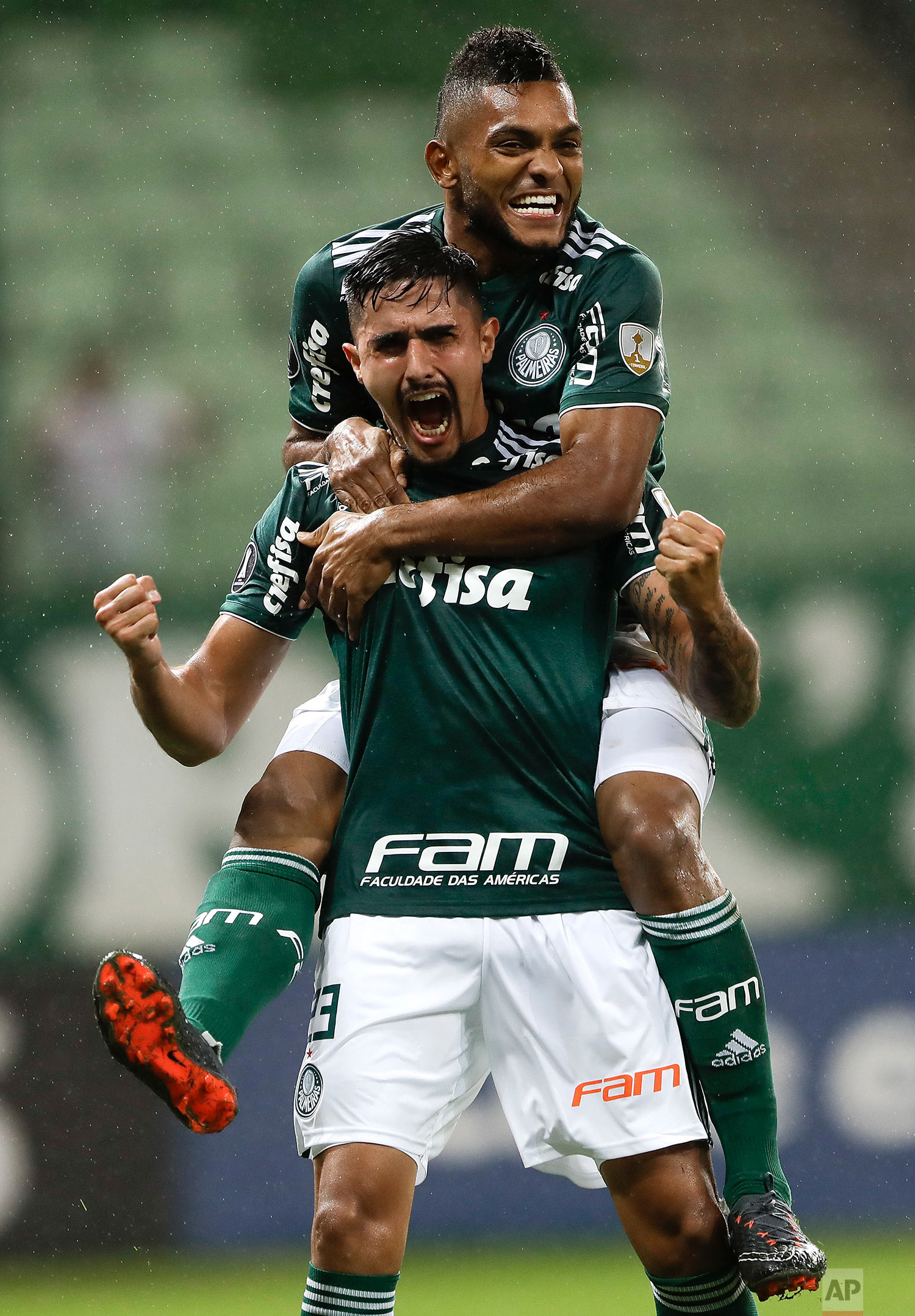 Thiago Martins of Brazil's Palmeiras, front, celebrates with teammate Miguel Borja after scoring against Peru's Alianza Lima at a Copa Libertadores soccer match in Sao Paulo, Brazil, Tuesday, April 3, 2018. (AP Photo/Andre Penner)