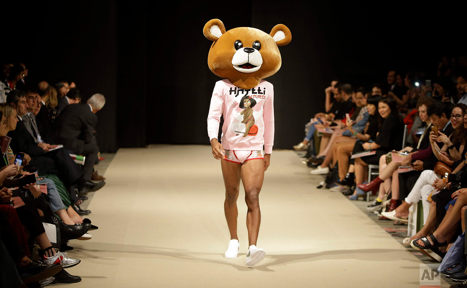 A model wears a creation from the VNRO autumn/winter collection during Fashion Week in Lima, Peru, Wednesday, April 25, 2018. (AP Photo/Martin Mejia)