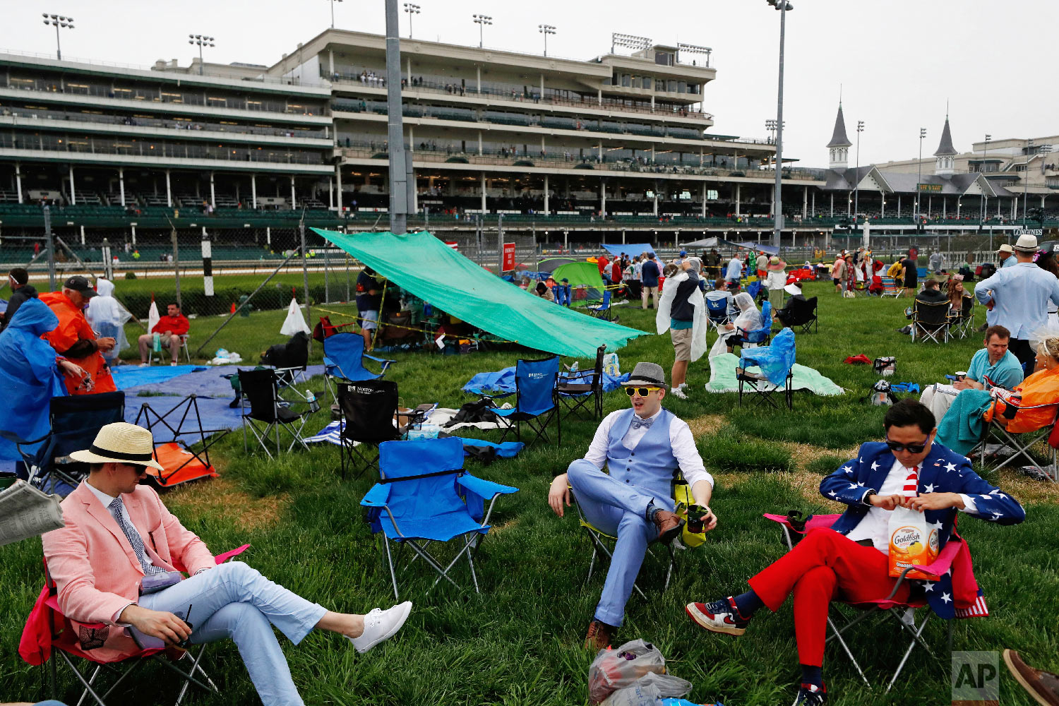 Fans relax in the infield before the 144th running of the Kentucky Derby horse race at Churchill Downs Saturday, May 5, 2018, in Louisville, Ky. (AP Photo/John Minchillo)