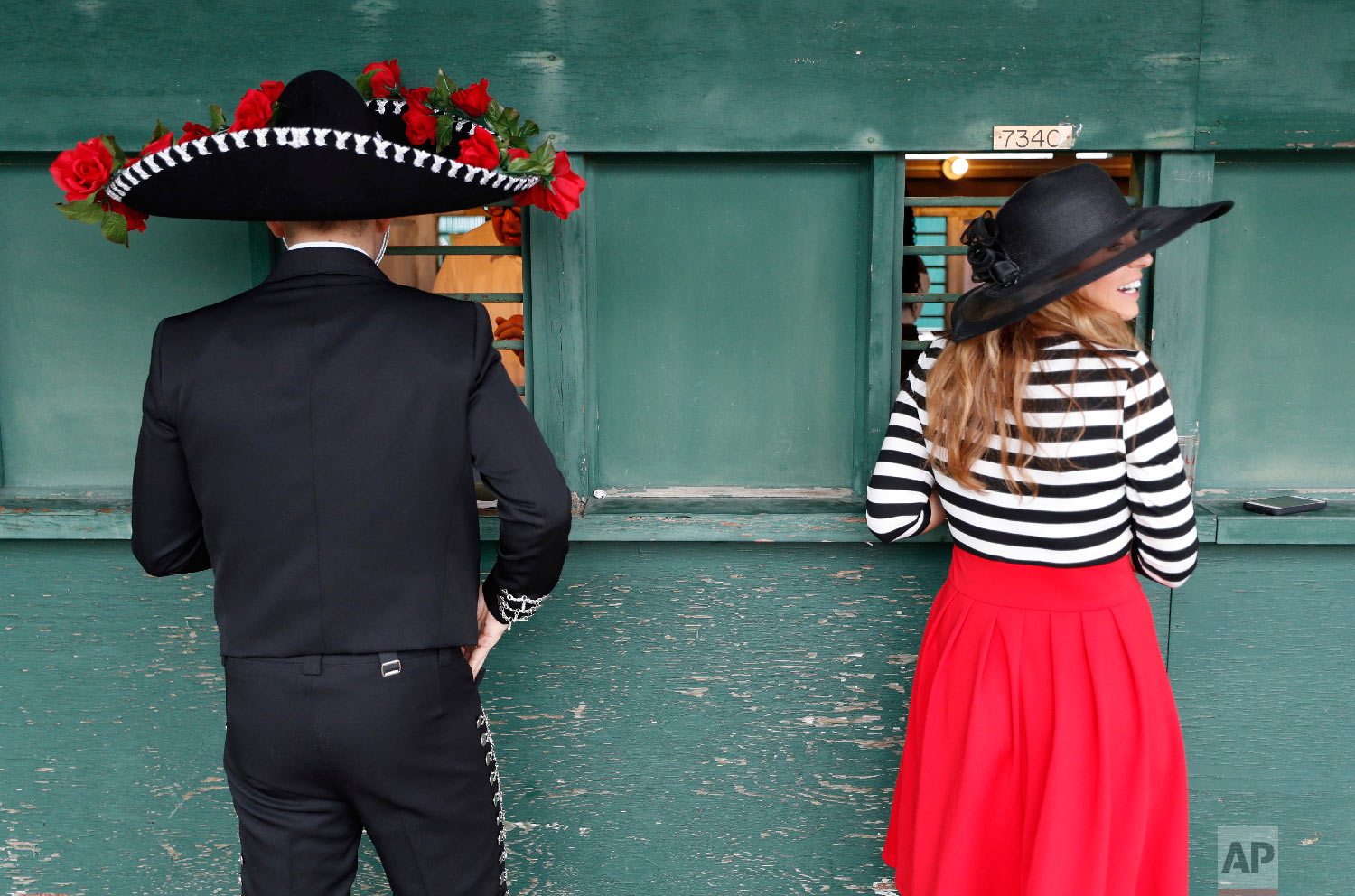 Fans place bets before the 144th running of the Kentucky Derby horse race at Churchill Downs Saturday, May 5, 2018, in Louisville, Ky. (AP Photo/John Minchillo)
