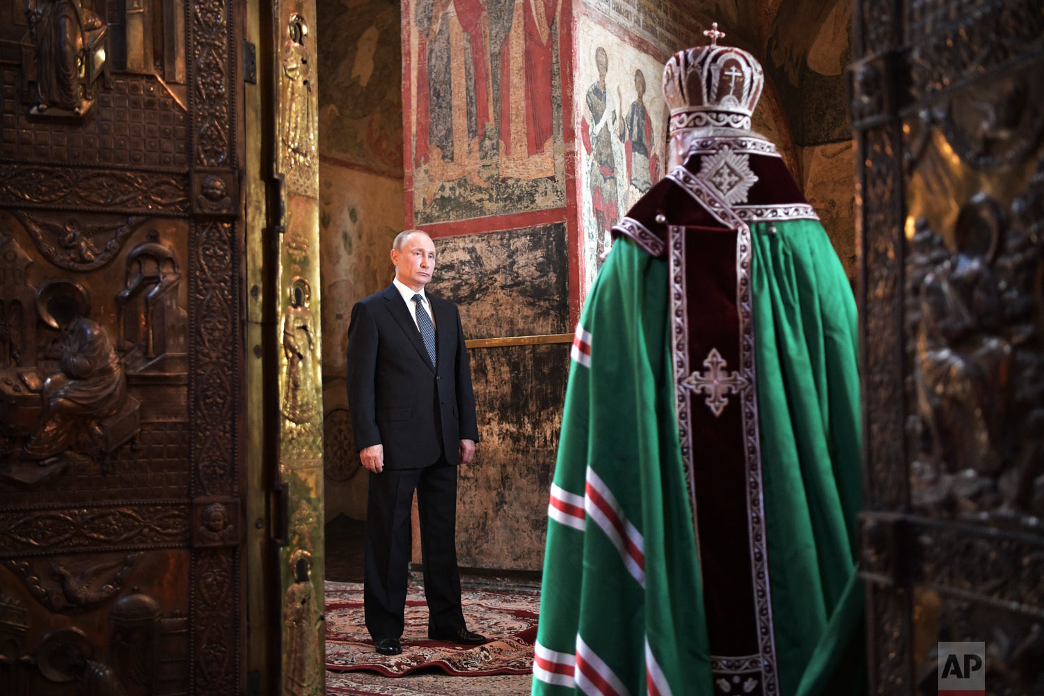 Russian President Vladimir Putin attends a service held by Russian Orthodox Patriarch Krill, right, in the Annunciation Cathedral after Putin's inauguration ceremony in the Kremlin in Moscow, Russia, on Monday, May 7, 2018. Putin took the oath of office for his fourth term as Russian president and promised to pursue an economic agenda that would boost living standards across the country. (Alexei Nikolsky, Sputnik, Kremlin Pool Photo via AP)