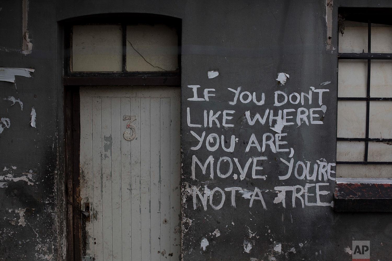 A message covers an occupied building complex. April 9, 2018. (AP Photo/Bram Janssen)