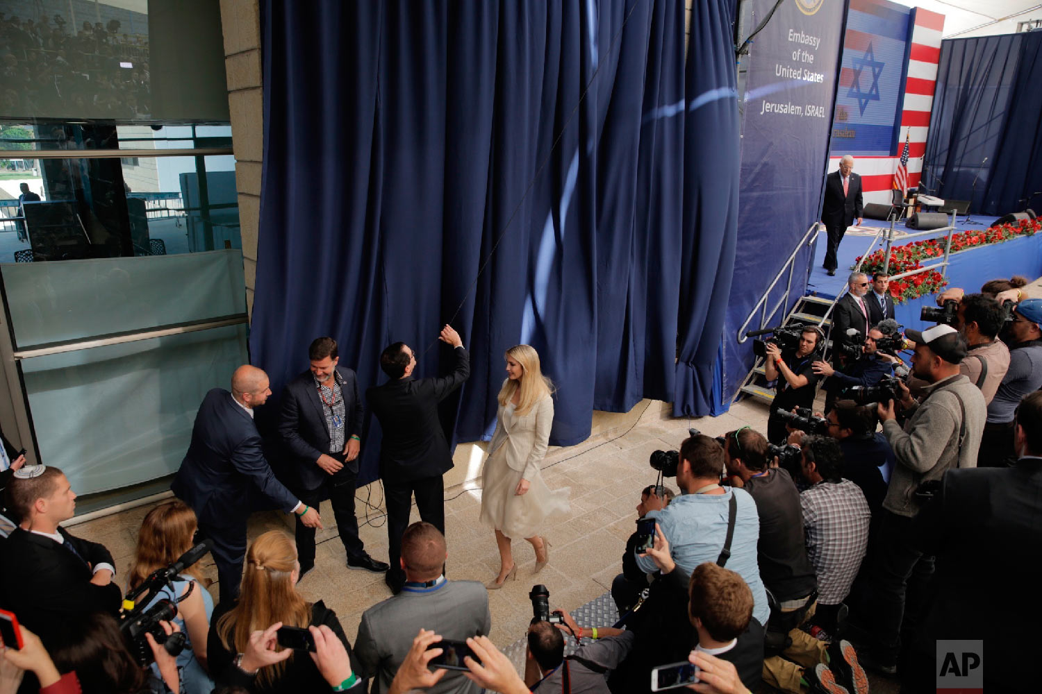 U.S. President Donald Trump's daughter Ivanka Trump, right, and U.S. Treasury Secretary Steve Mnuchin unveil an inauguration plaque during the opening ceremony of the new US embassy in Jerusalem, Monday, May 14, 2018. (AP Photo/Sebastian Scheiner)