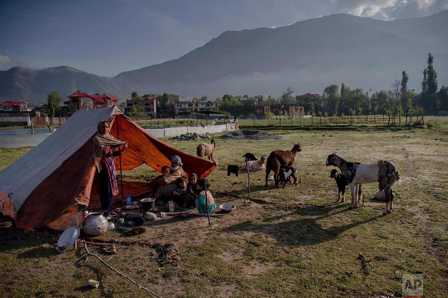 In this May 9, 2018, photo, a Kashmiri nomadic Bakarwal family camps in outskirts of Srinagar, Indian controlled Kashmir. (AP Photo/Dar Yasin)