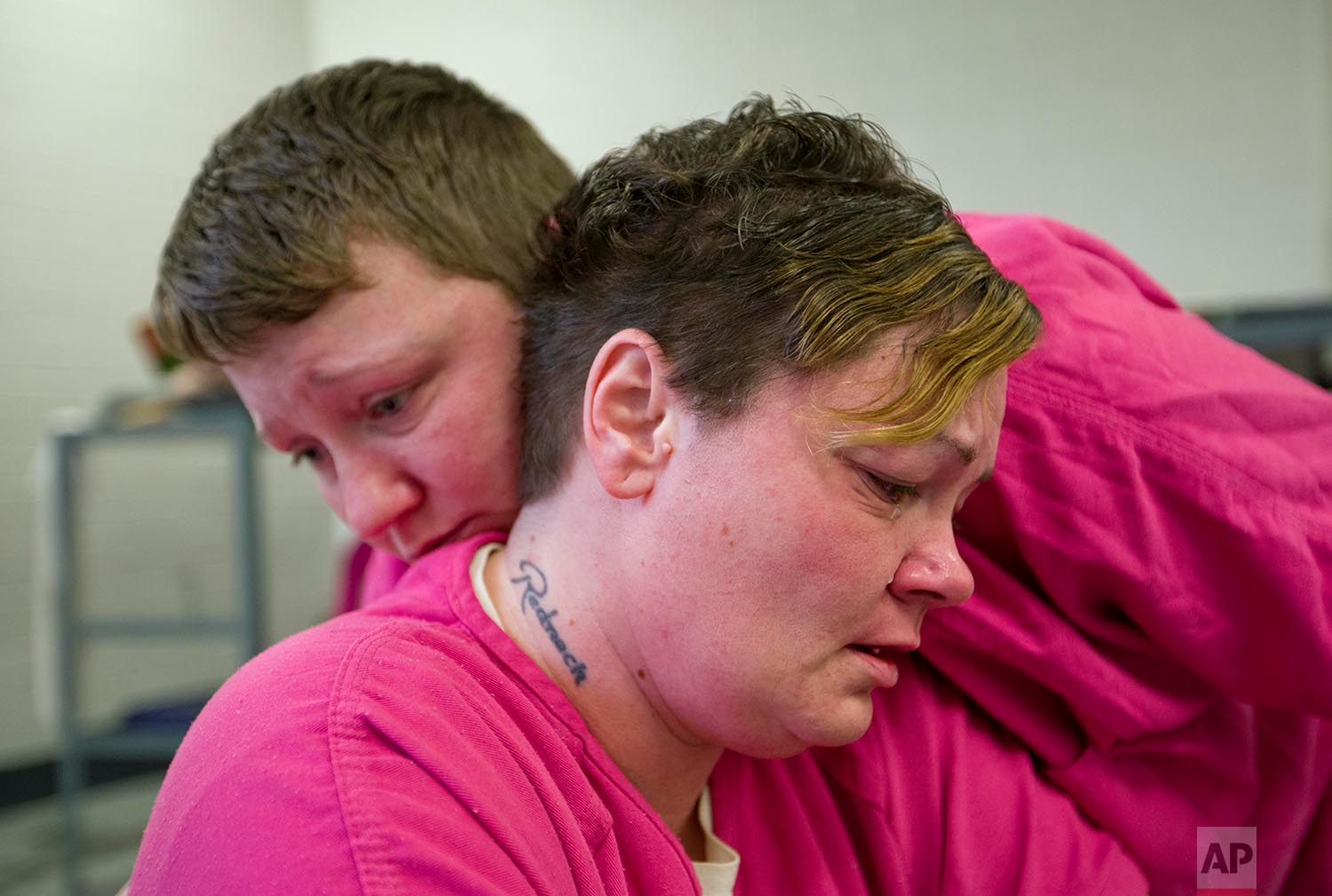 Mary Sammons, foreground, is comforted in the Campbell County Jail in Jacksboro, Tenn., Wednesday, March 28, 2018, by cellmate Blanche Ball, days after Sammons learned that her 20-year-old son was murdered in Kentucky. (AP Photo/David Goldman)