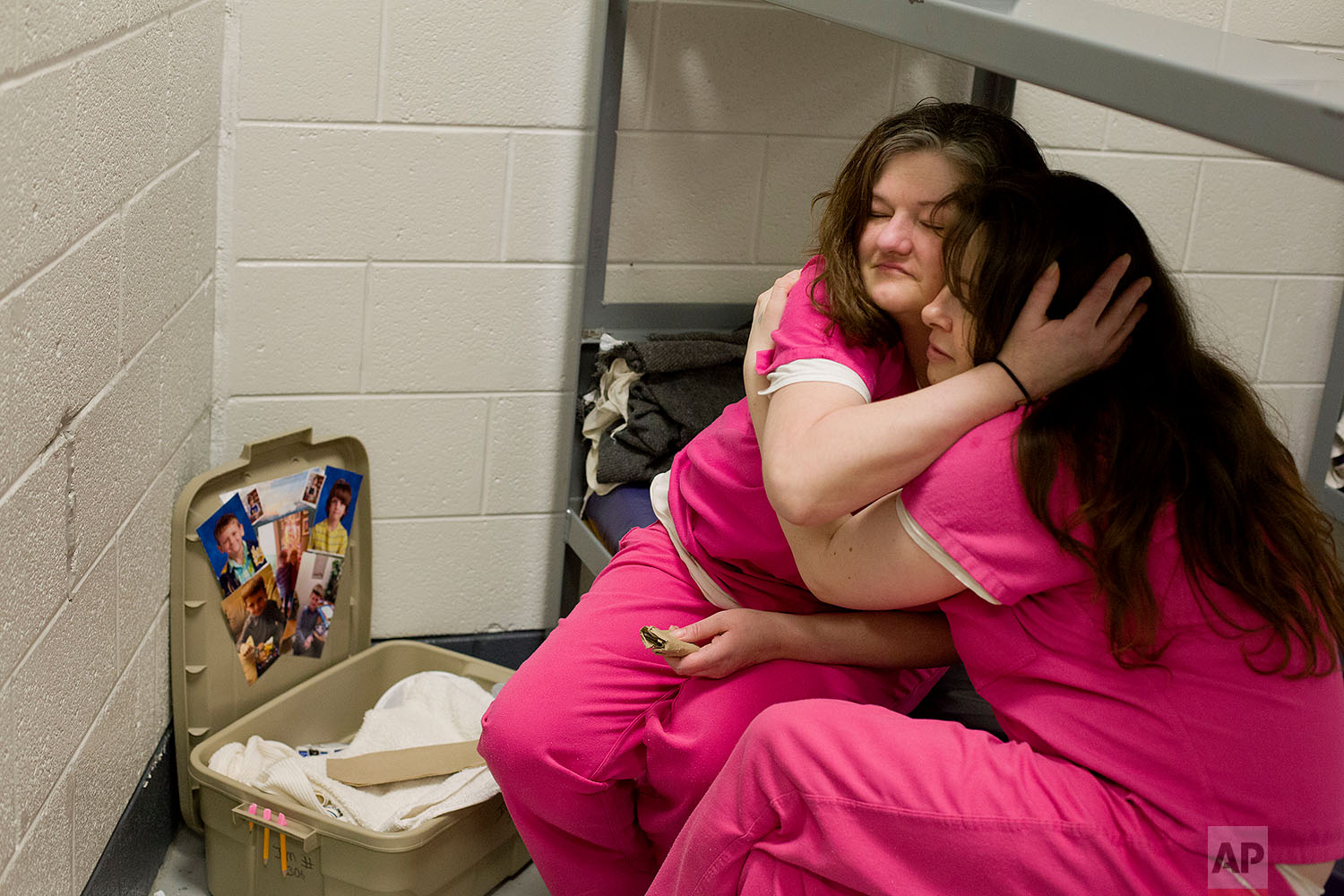Crystal French, left, is comforted by cellmate Krystle Sweat, at the Campbell County Jail in Jacksboro, Tenn., Tuesday, March 30, 2018, after French was denied parole the previous day. She won't be eligible again for another year. (AP Photo/David Goldman)