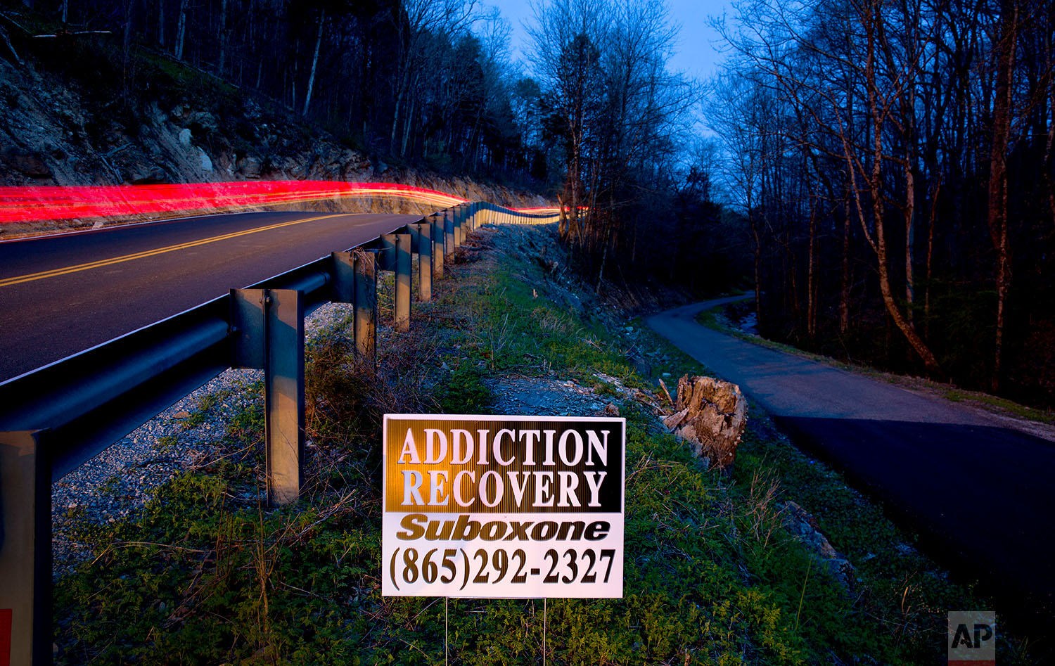 An addiction recovery sign stands beside a road in LaFollette, Tenn., Wednesday, April 11, 2018. (AP Photo/David Goldman)