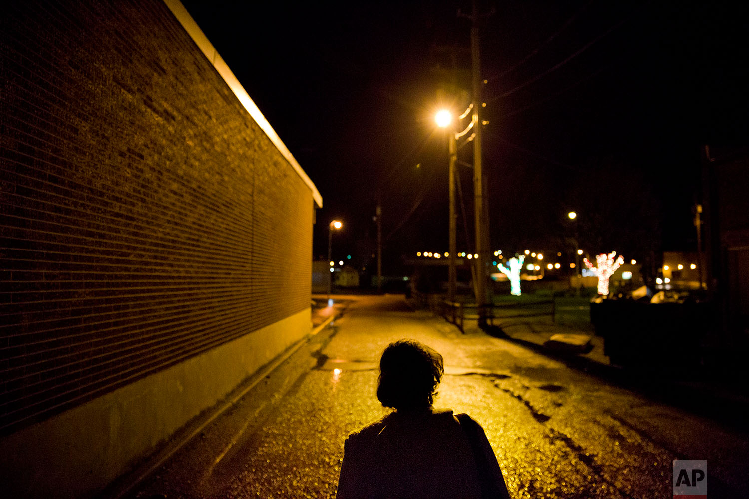 Tammy Perry walks through the street in LaFollette, Tenn., where she is currently staying after getting out of jail, Monday, April 23, 2018. (AP Photo/David Goldman)