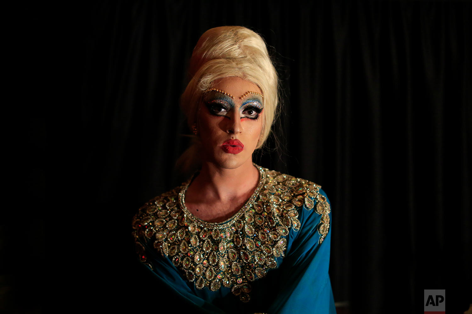In this picture taken Sunday, May 13, 2018, Drag queen Emma Gration poses for a picture before performs during a Sunday drag queen show, called the drag ball, during Beirut Pride week, north of the capital Beirut, Lebanon. (AP Photo/Hassan Ammar)