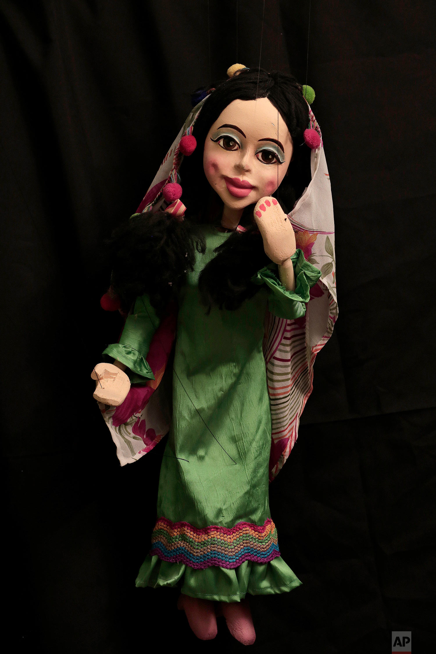 Amr Fawzi in egypt, a marionette maker strings together memories — ap