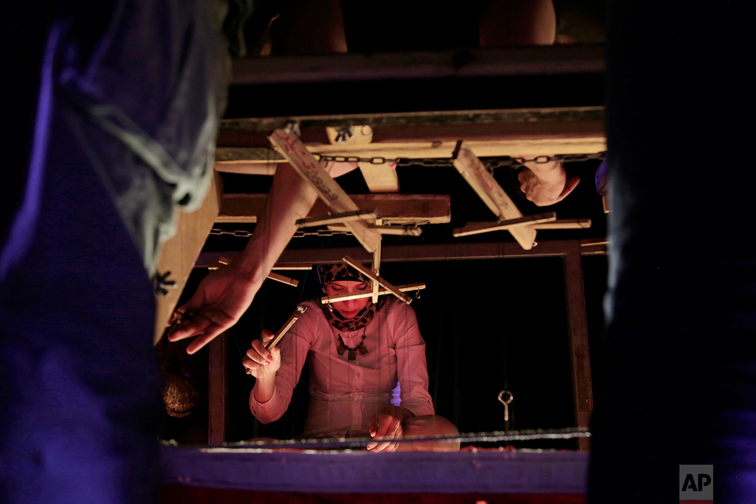 Puppeteer artist part Egyptian artist Mohamed Fawzi Bakkar's team moves a puppet and preforms with Umm Kalthoum, the most famed singer of classical Arabic music, marionettes during a performance at the El Sawy Cultural Center, in Cairo, Egypt, May 3, 2018. (AP Photo/Nariman El-Mofty)