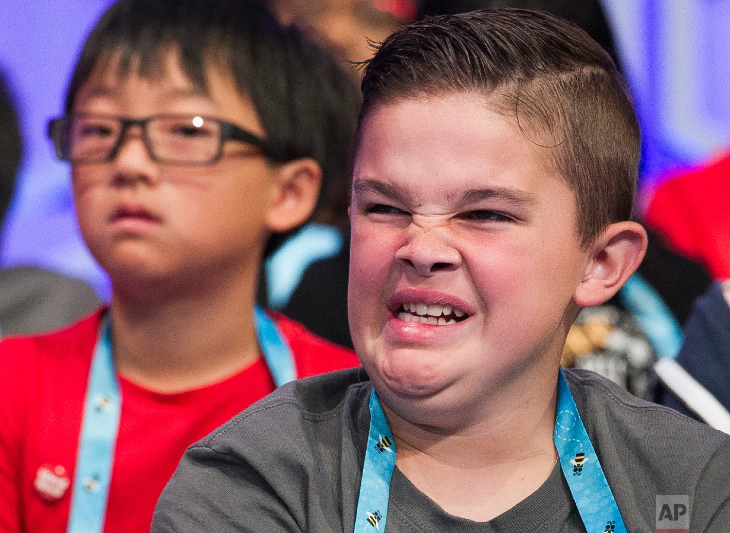 Matthew Rodgers, 13, from Severance, Colo., waits to spell his word during the third round of the Scripps National Spelling Bee in Oxon Hill, Md., Wednesday, May 30, 2018. (AP Photo/Cliff Owen)
