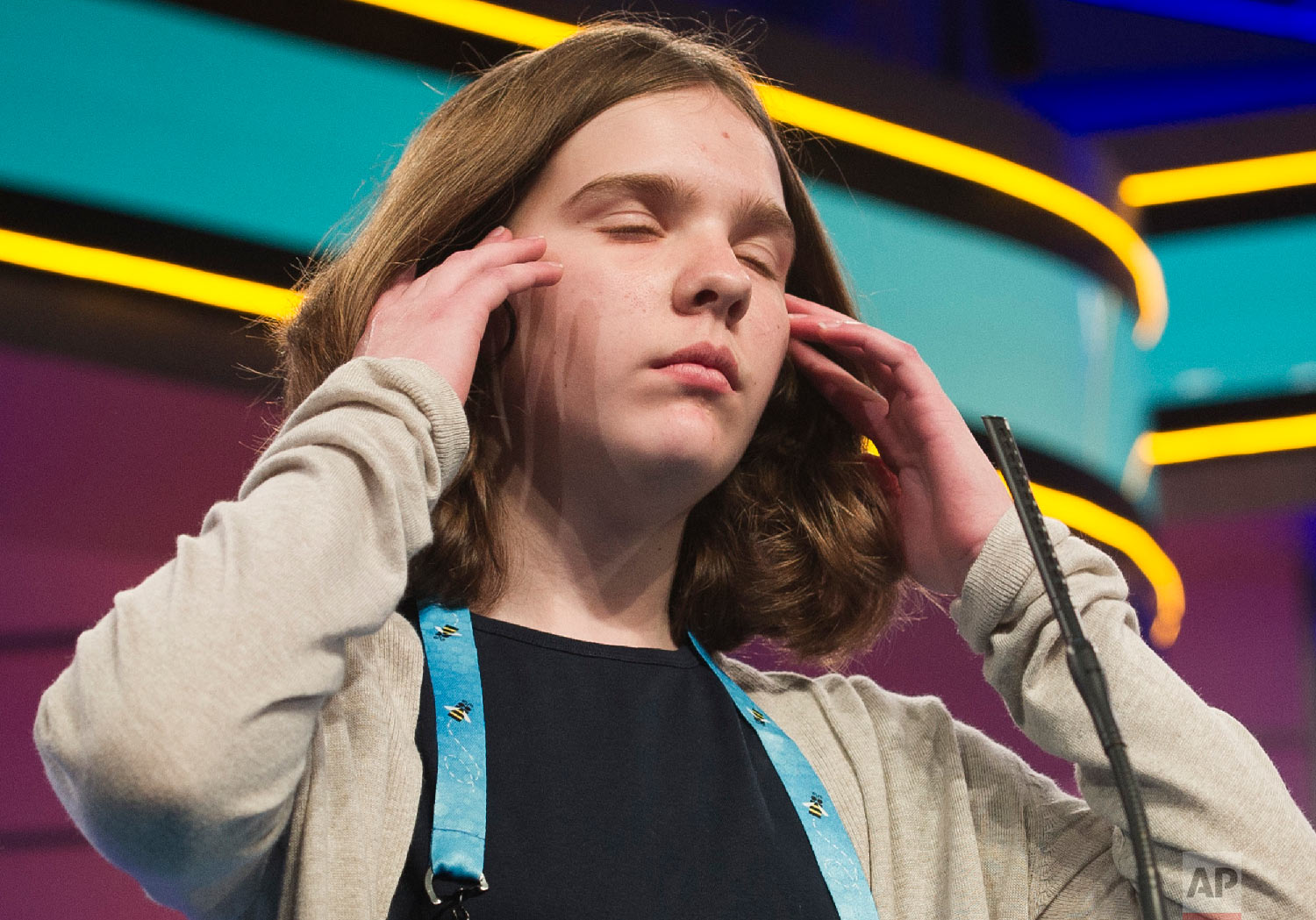 Erin Howard, 13, from Huntsville, Ala., spells her word correctly during the third round of the Scripps National Spelling Bee in Oxon Hill, Md., Wednesday, May 30, 2018. (AP Photo/Cliff Owen)