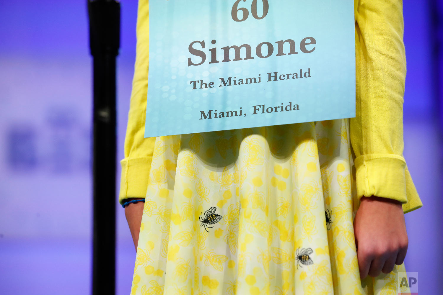 Simone Kaplan, 12, from Davie, Fla., wears a dress with bees on it during the 2nd Round of the Scripps National Spelling Bee, Tuesday, May 29, 2018, in Oxon Hill, Md. (AP Photo/Alex Brandon)