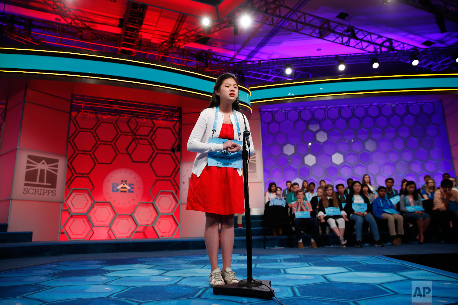 Amy Jung, 15, from Busan, South Korea, spells a word incorrectly during the 3rd Round of the Scripps National Spelling Bee in Oxon Hill, Md., Wednesday, May 30, 2018. (AP Photo/Carolyn Kaster)