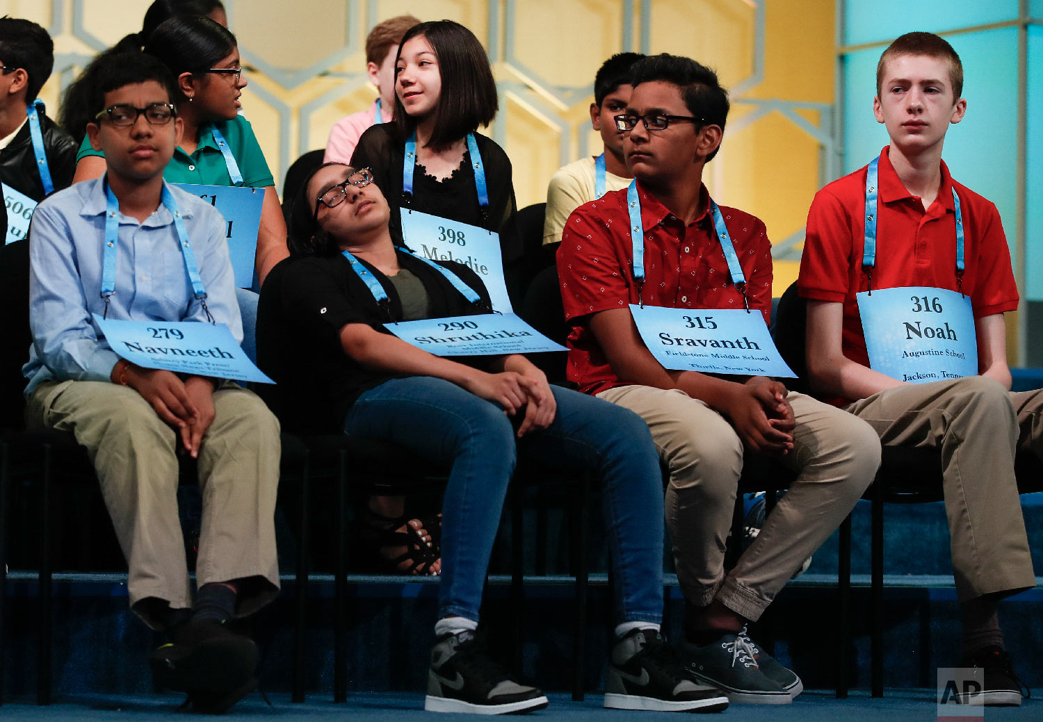 Shruthika Padhy, 12, from Cherry Hill, N.J. second from left, slumps in her chair and closes her eyes as she sits with from left, Navneeth Murali, 12, from Edison, N.J. Sravanth Malla, 14, from Haverstraw, N.Y., and Noah Brandt, 15, from Jackson, Tenn., during the final round of the Scripps National Spelling Bee in Oxon Hill, Md., Thursday, May 31, 2018. (AP Photo/Carolyn Kaster)