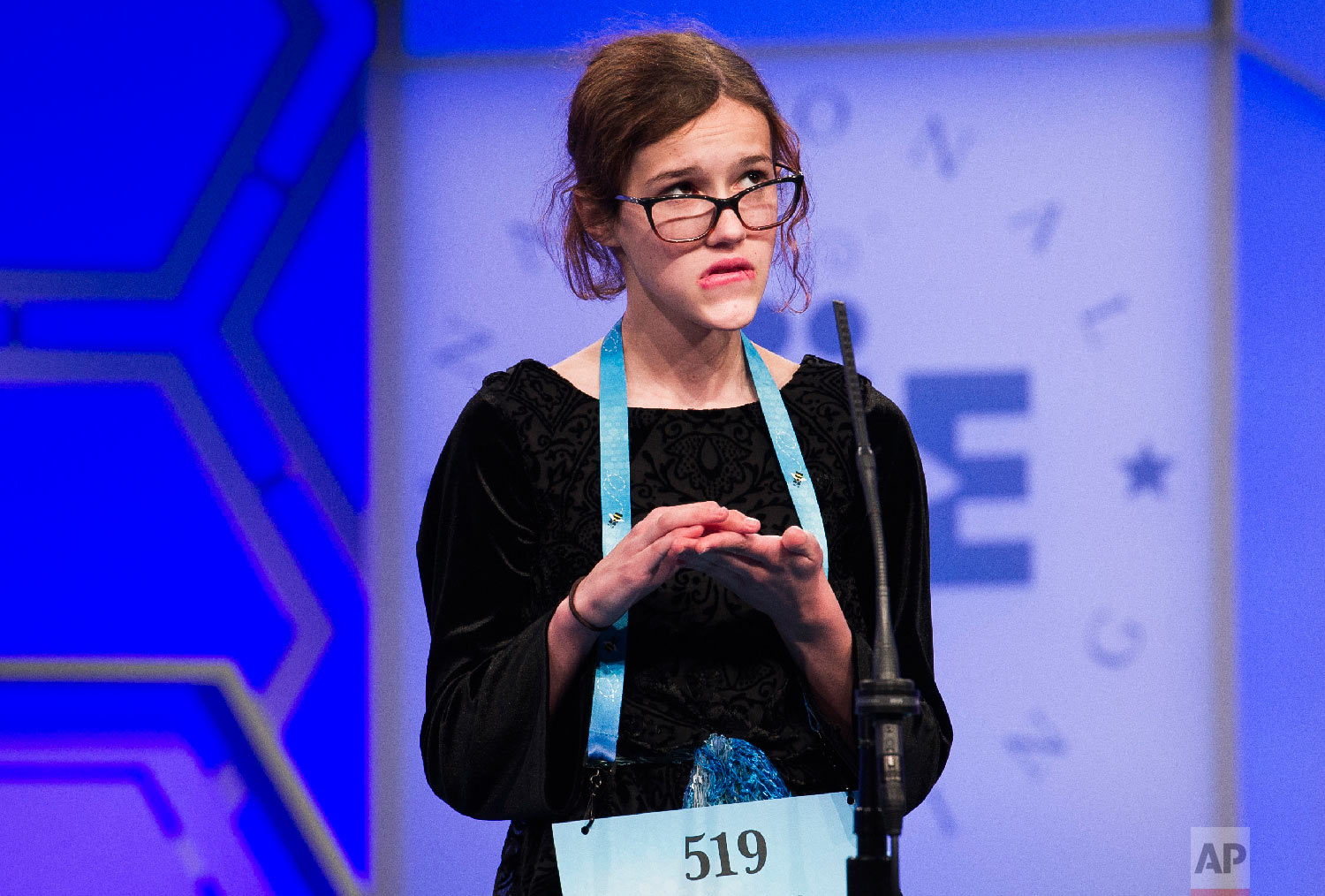 The last speller of the day, Eleanor Tallman, 13, from Flower Mound, Texas, spells her word incorrectly during the second round of the Scripps National Spelling Bee in Oxon Hill, Md., Tuesday, May 29, 2018. (AP Photo/Cliff Owen)