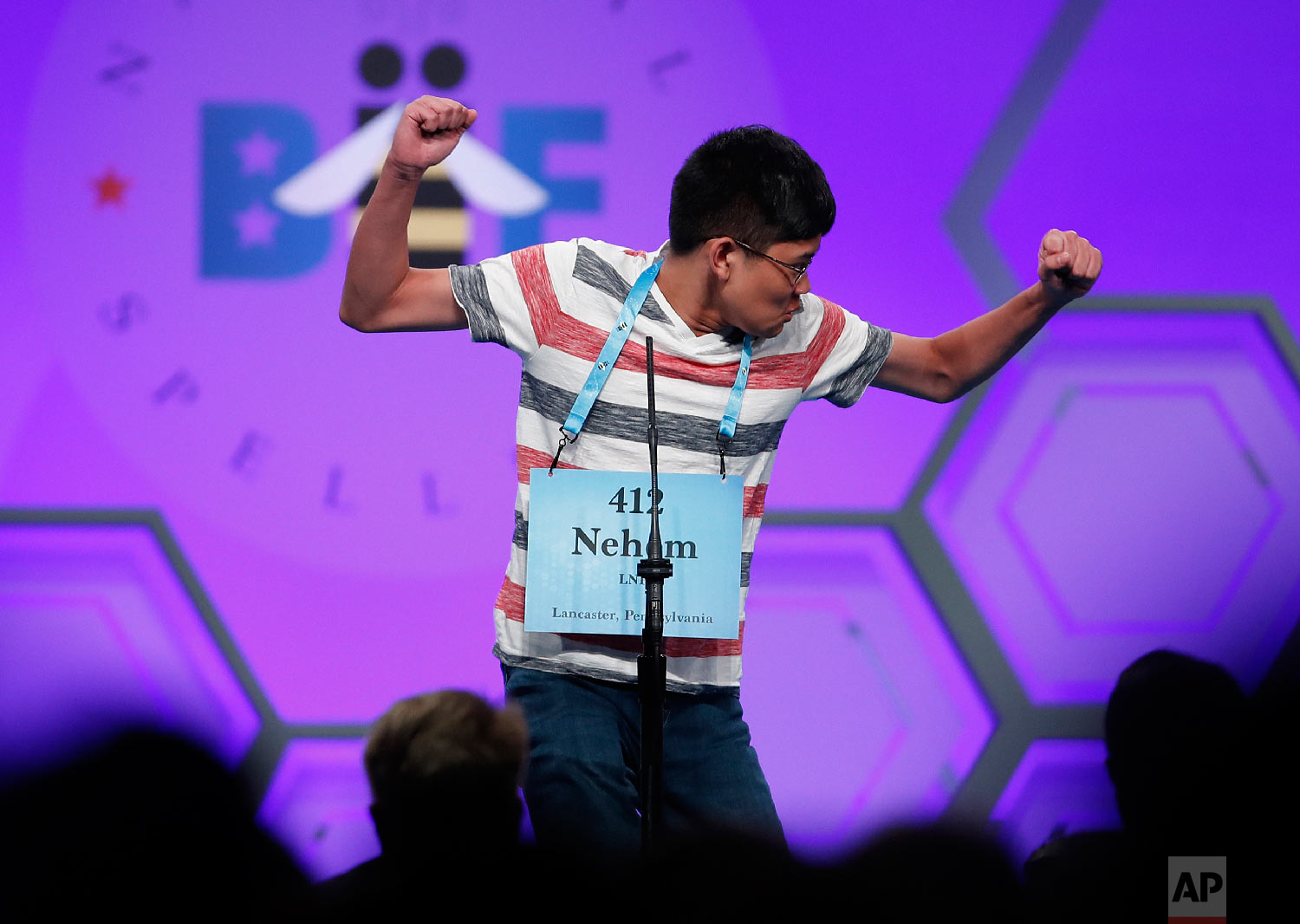 Nehem Felices, 13, from Lancaster, Pa., reacts after spelling a word correctly during the 3rd Round of the Scripps National Spelling Bee in Oxon Hill, Md., Wednesday, May 30, 2018. (AP Photo/Carolyn Kaster)