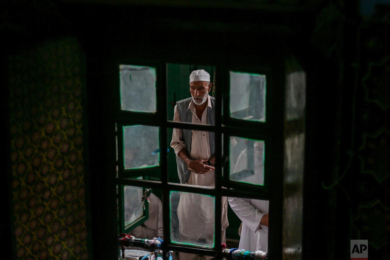 A Kashmiri man prays inside the Shah-e-Hamdan mosque during Ramadan in Srinagar, Indian controlled Kashmir, Friday, June 1, 2018. Islam's holiest month is a period of intense prayer, dawn-to-dusk fasting and nightly feasts. (AP Photo/Dar Yasin)