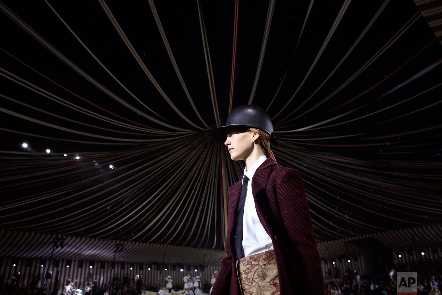 A model wears a creation for Dior's Cruise 2019 fashion collection in Chantilly, north of Paris, Friday, May 25, 2018. (AP Photo/Thibault Camus)