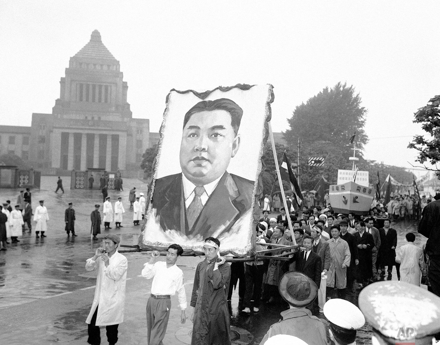 North Korean demonstrators carry a portrait of their country's Communist Prime Minister, Kim Il Sung, in front of the Japanese National Diet (parliament) building in Tokyo during May Day festivities on May 2, 1959. (AP Photo)