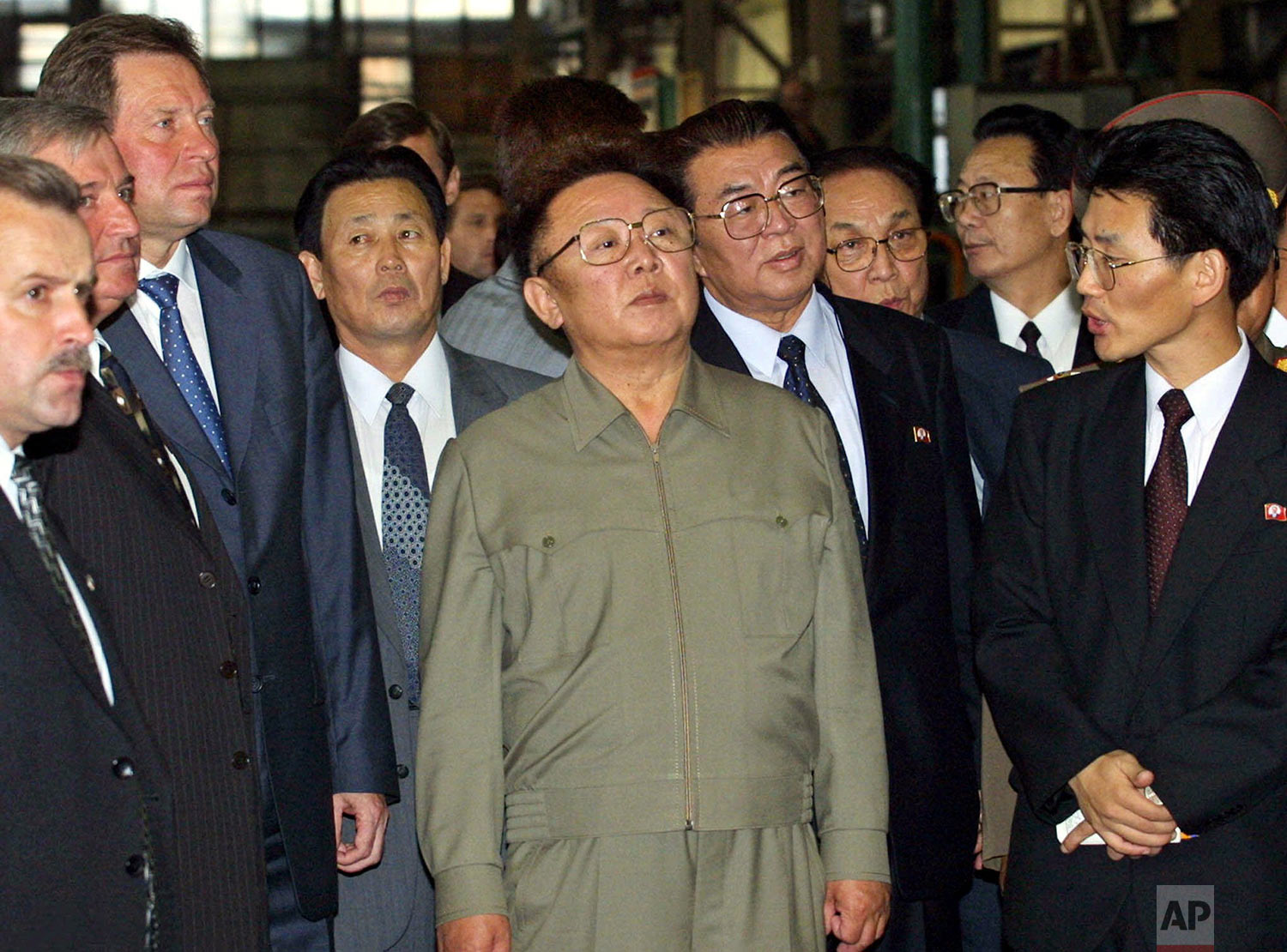 North Korean leader Kim Jong Il, center, examines the rotor for Iran's Busher nuclear power station at the Leningradsky Metal Factory in St. Petersburg, Russia, on Aug. 6, 2001. (AP Photo/Dmitry Lovetsky, Pool)