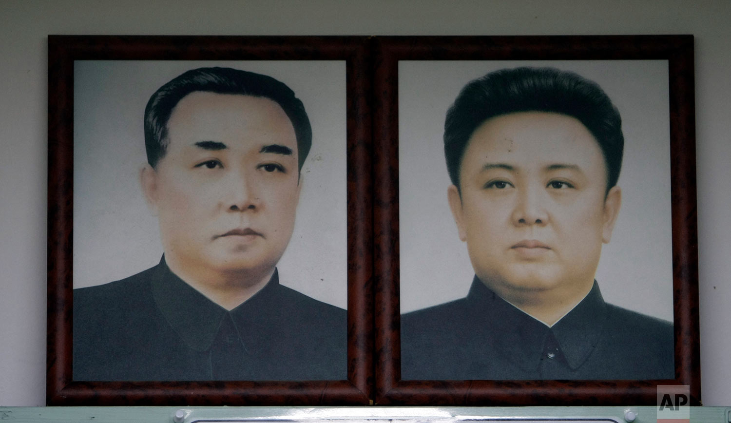 Portraits of North Korean leader Kim Jong Il, right, and his late father, Kim Il Sung, hang at a unification observation post in Paju, South Korea, near the border village of Panmunjom that has separated the two Koreas since the Korean War, on Jan. 22, 2010. (AP Photo/ Lee Jin-man)