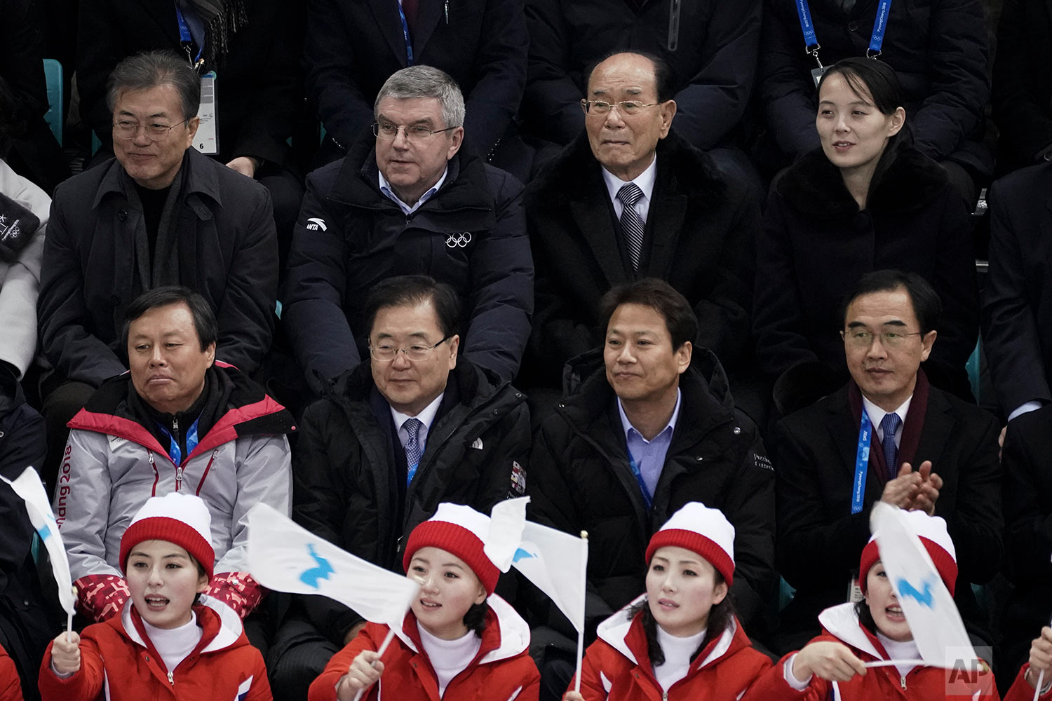 Kim Yo Jong, sister of North Korean leader Kim Jong Un, top right, and North Korea's nominal head of state Kim Yong Nam, second right, Thomas Bach, President of the International Olympic Committee, and South Korean President Moon Jae-in, top left, watch the preliminary round of the women's hockey game between Switzerland and the combined Koreas at the 2018 Winter Olympics in Gangneung, South Korea, Feb. 10, 2018 . (AP Photo/Felipe Dana)
