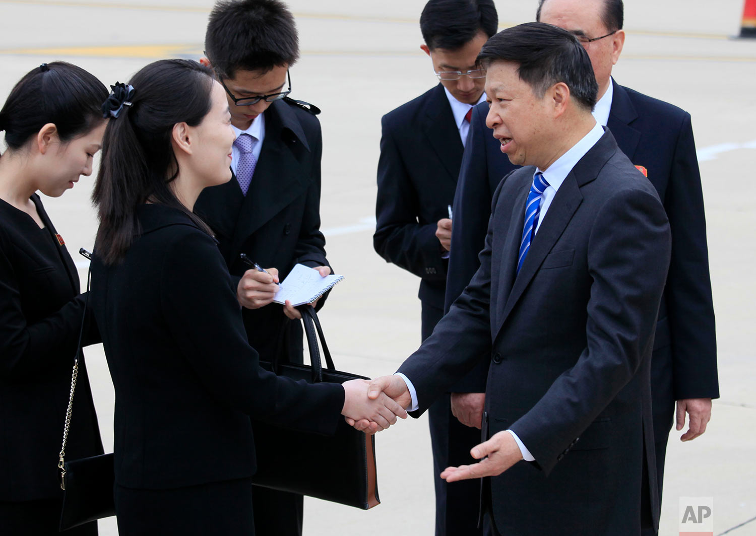 Song Tao, right, head of the Chinese Communist Party Central Committee's international department, shakes hands with Kim Yo Jong, the sister of North Korean leader Kim Jong Un, as a Chinese art troupe led by Song arrives at Pyongyang Airport in North Korea on April 13, 2018. (AP Photo/Jon Chol Jin)