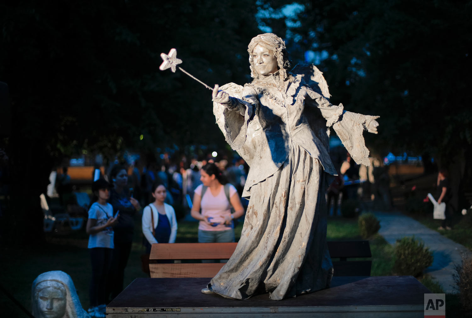An artist of The Netherlands' Levend Theater performs the Angel character during the Living Statues International Festival, in Bucharest, Romania on Tuesday, May 22, 2018.(AP Photo/Vadim Ghirda)
