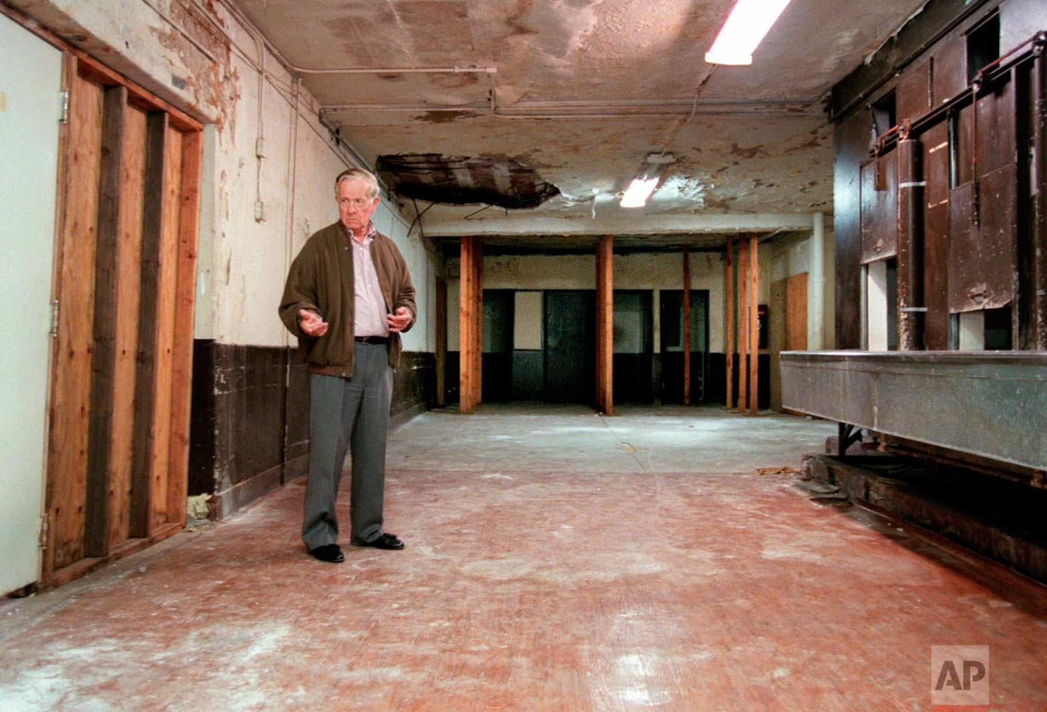 In this June 5, 1998 photo, Associated Press reporter Bob Thomas stands on the spot where Sen. Robert F. Kennedy lay on the floor after he was shot in an Ambassador Hotel pantry precisely 30 years earlier in Los Angeles. (AP Photo/Reed Saxon)
