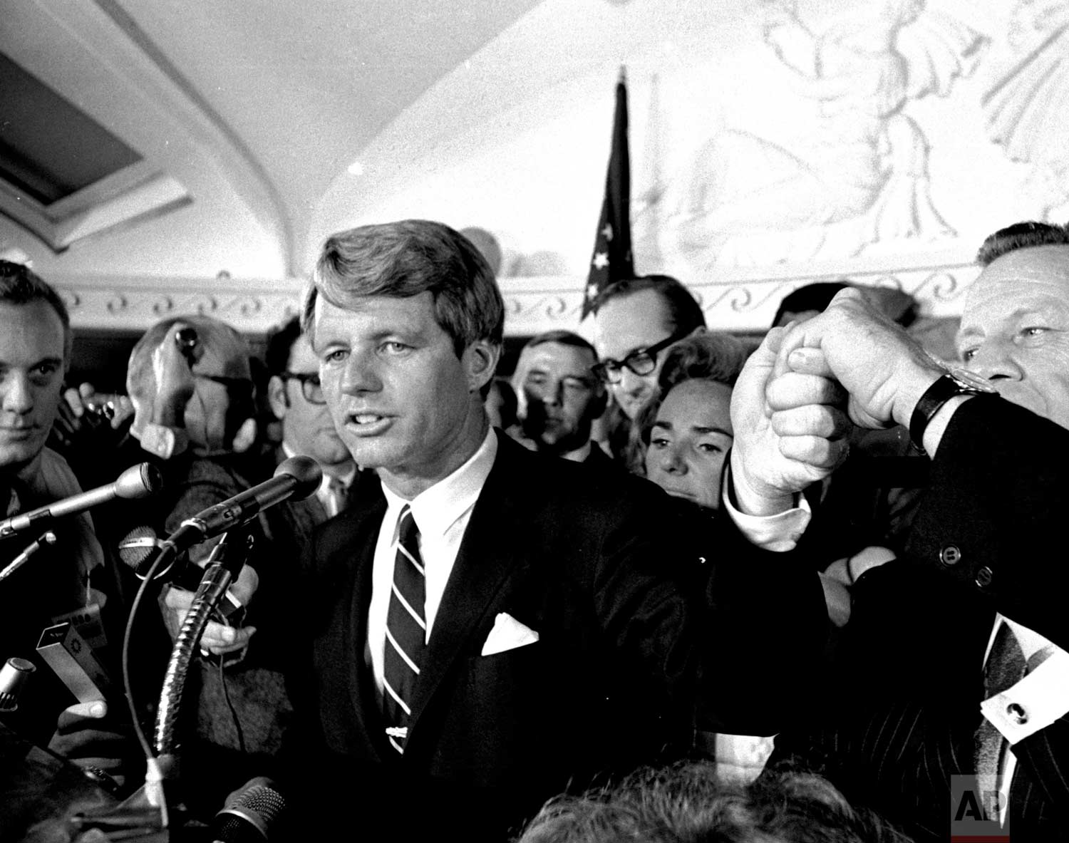 This June 5, 1968 photo shows Sen. Robert F. Kennedy speaking at the Ambassador Hotel in Los Angeles, following his victory in the previous day's California primary election. The New York senator was shot just after jubilantly proclaiming victory in California's Democratic presidential primary election. (AP Photo/Dick Strobel)
