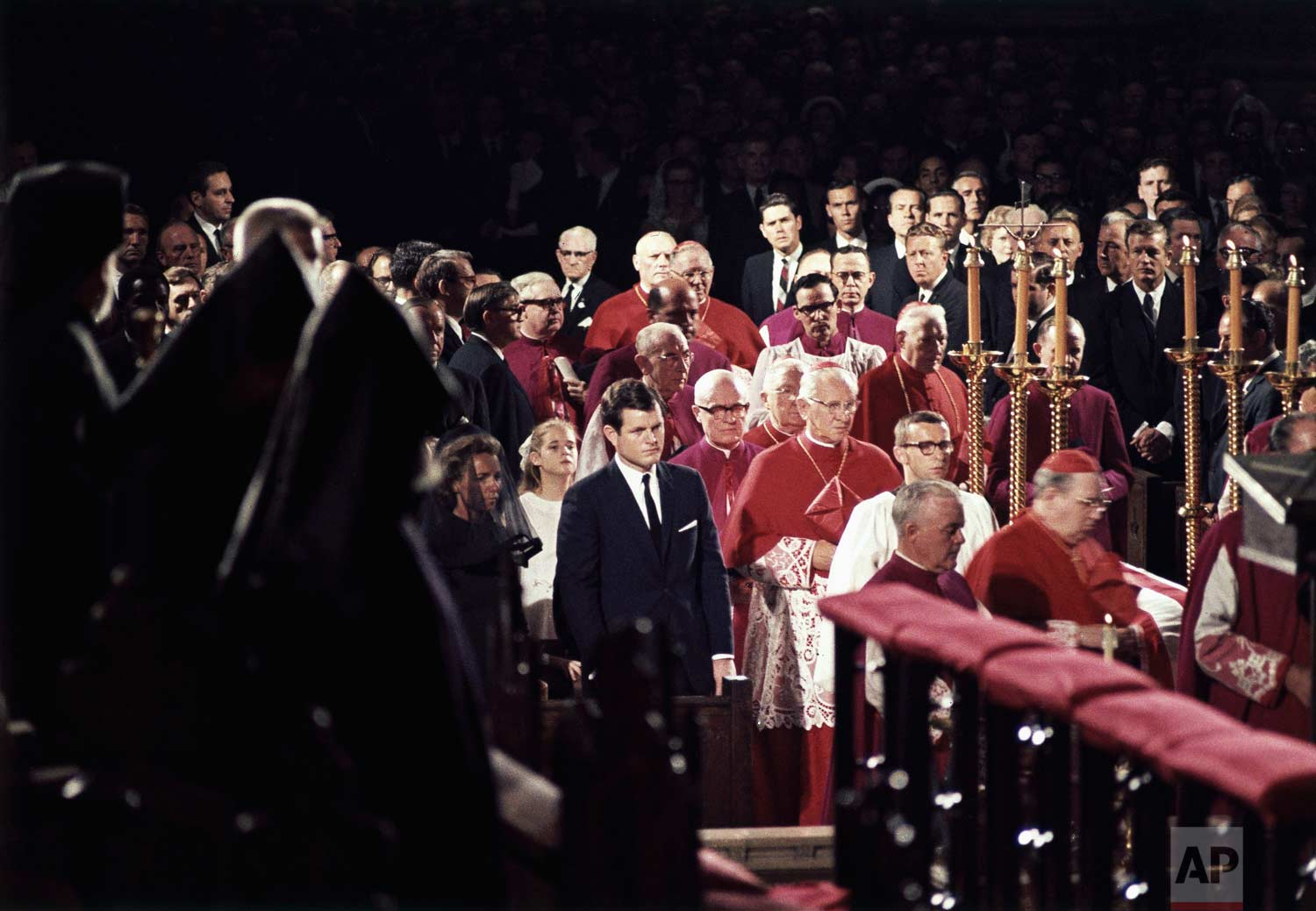 Edward M. Kennedy, center, stands with the widow of his brother, Robert F. Kennedy, during his funeral at St. Patrick's Cathedral in New York, June 8, 1968. (AP Photo)