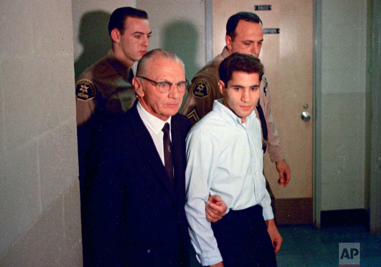 This June 1968 photo shows Sirhan Sirhan, right, a suspect of shooting Sen. Robert F. Kennedy, with his attorney Russell E. Parsons in Los Angeles. Associated Press Hollywood reporter Bob Thomas was on a one-night political assignment in June 1968 to cover Kennedy's victory in the California presidential primary when mayhem unfolded before his eyes. (AP Photo)