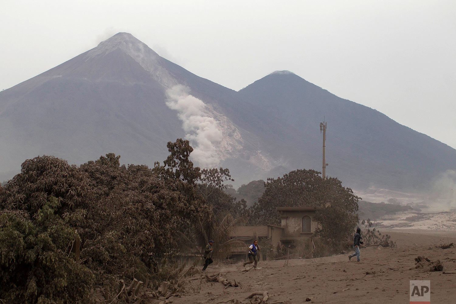 The Volcan de Fuego, or Volcano of Fire, continues to spill out smoke and ash as residents evacuate Escuintla, Guatemala, Monday, June 4, 2018. (AP Photo/Luis Soto)