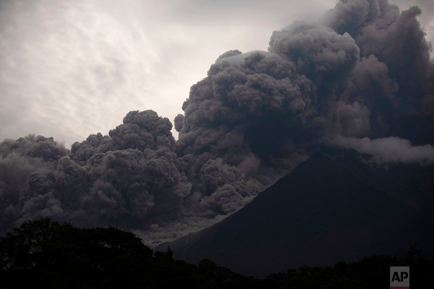 Volcan de Fuego, or Volcano of Fire, blows outs a thick cloud of ash, as seen from Alotenango, Guatemala, June 3, 2018. (AP Photo/Santiago Billy)