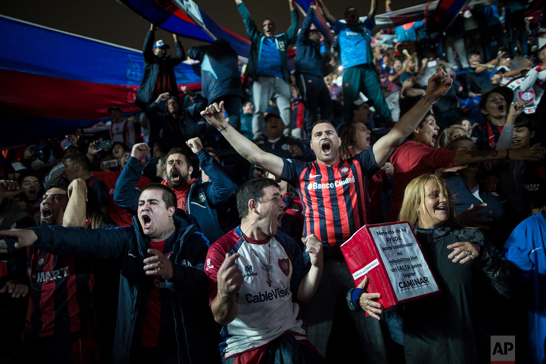 San Lorenzo fans celebrate a goal against Belgrano de Cordoba in the grandstand in Buenos Aires, Argentina, May 4, 2018. (AP Photo/Rodrigo Abd)