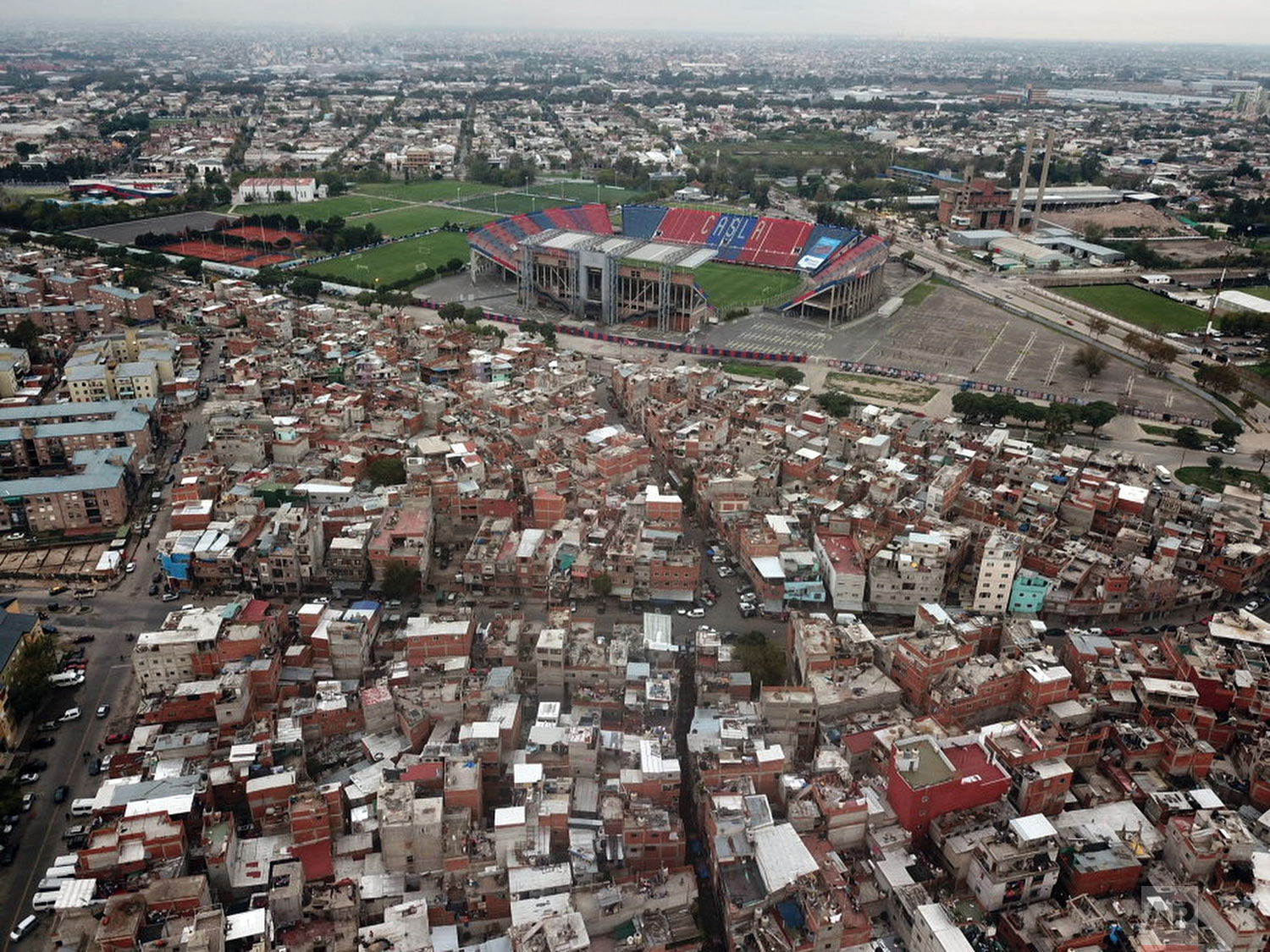 """The San Lorenzo soccer team stadium stands amid low income homes in the """"Bajo Flores"""" neighborhood of Buenos Aires, Argentina, April 27, 2018. (AP Photo/Rodrigo Abd)"""