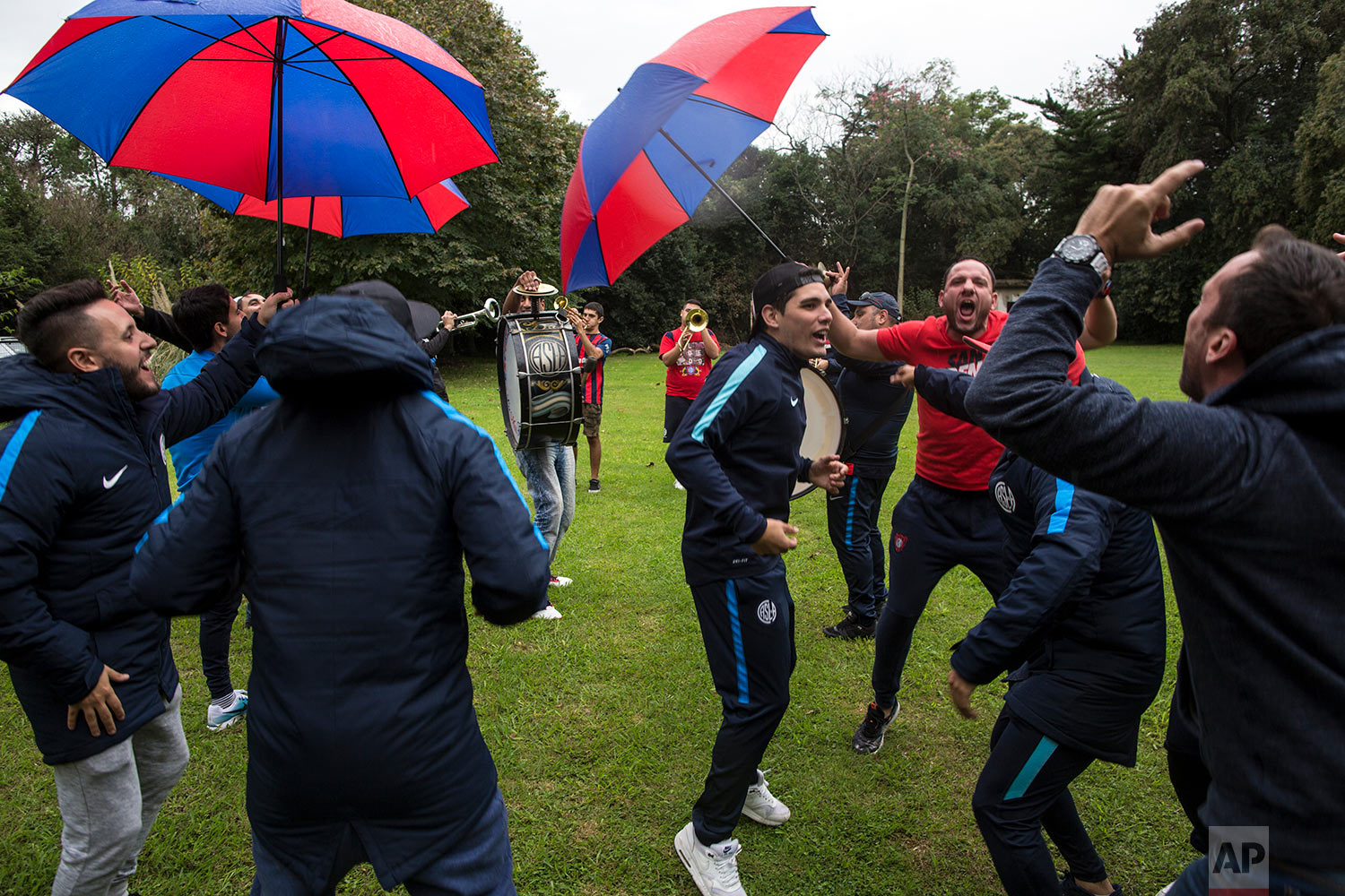 """In this May 1, 2018 photo, members of the """"School of Planks,"""" the musical fan club of San Lorenzo's soccer team, dance as they work on new songs for the fans of Argentina's national soccer team and their local team of San Lorenzo in Buenos Aires, Argentina. (AP Photo/Rodrigo Abd)"""
